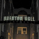 Brenton Hall sign at night