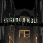 Brenton Hall sign at night