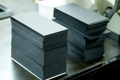 Stacks of cut Plike paper. Paper cutting isn't glamorous, but it's a very important step.