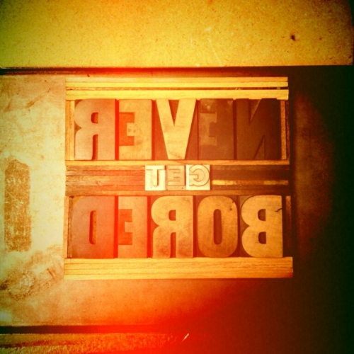 Never Get Bored, wood and metal type lockup