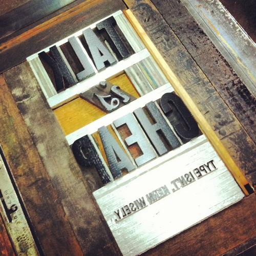 Talk is Cheap, wood and metal type lockup