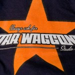 A new Star Waggons employee t-shirt, one of the first items to bear the new logo.