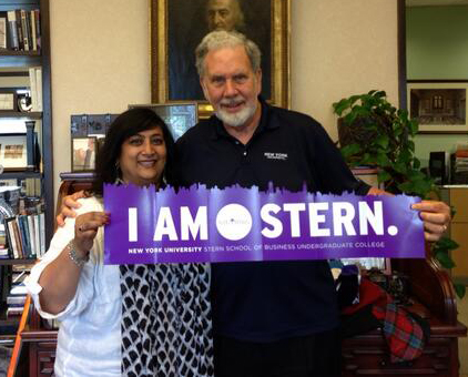NYU President John Sexton with Dean Menon and I AM STERN banner